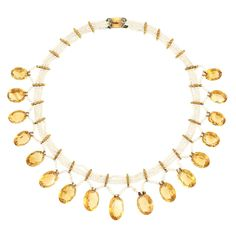 Triple Strand Seed Pearl, Gold and Citrine Fringe Necklace  16 oval citrines. Length 13 1/2 inches.