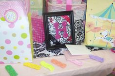 Damask baby shower - fun gift for baby girl to be: hair bow organizer. (two ribbons hang from bottom of photo frame-clip bows to those.)