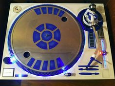 A R2-D2 turntable would make any wannabe DJ an uber geek and super chic in my books.