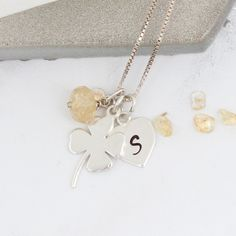 A shiny sterling silver 4 leaf clover necklace personalised with initial charm and November birthstone gemstone to create a unique good luck gift for someone who needs a bit of good fortune. Topaz Jewelry, Jewellery, Good Luck Gifts, Good Luck Necklace, Clover Necklace, Golden Necklace, Leaf Clover, Initial Charm, Christening