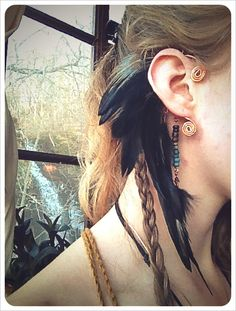 {mohawk a tribal feathered ear cuff by RunWithTheTribe on Etsy, $36.00}  Thank you, Pinterest, for showing me what ear cuffs are!