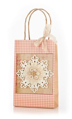 Love this festive gift bag. So soft and pretty! Kazan Clark I love the buttons!