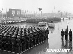 A military parade is held in the rain to mark the 7th anniversary of the founding of the People's Republic of China at Tian'anmen Square in Beijing on October 1, 1956
