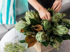 This DIY artichoke and magnolia centerpiece would look great sitting on a concrete or cement tabletop