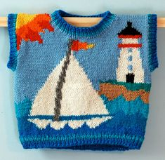 On the front is a sailboat gliding past a lighthouse. On the back is a tugboat. The sun and island are continuous. The ribbing at the neck, armhole openings, and hem is shades of blue.  Pattern has written directions, materials lists, and full color charts to enlarge. The pattern assumes a good knowledge of knitting, or at least an adventurous spirit and a knitting guidelines book. Obviously other color combinations are possible.  Have fun!    Finished size  Height 10.5  Width around 20…