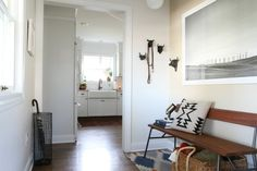 great entryway with bench and large scale neutral art