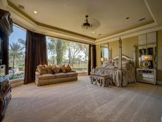 8 SOVEREIGN CIR RICHMOND, TX 77469: Photo Master bedroom offers spectacular views of the pool and 17 acre lake.