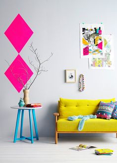What a cute living room for an apartment or kids room / colourful pieces