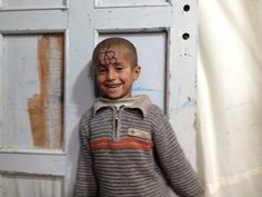 """""""I love butterflies, I want to fly like them.""""  """"Where to?""""  """"#Syria!""""  Five-year-old Nassar.  Photo: UNHCR/ E. Byun"""
