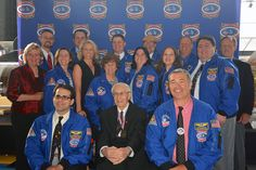 Members of the Space Camp Hall of Fame gather at the 2014 induction ceremony, Aug. 8 at the U.S. Space & Rocket Center in Huntsville, Alabama. Top row, left to right: Ed Van Cise (2012), Josh Whitfield (2008), Burke Hare (2011), Jim Allan (2009), Dan Oates (2007) and Hoot Gibson (2012). Middle row: Mary Tuncer, for her late husband (2014), Liz Warren (2012), Michelle Ham (2014), Marlenn Maicki (2008), Penny Pettigrew (2007), Amanda Stubblefield (2007) and Robert Pearlman  (2009). Bottom row…