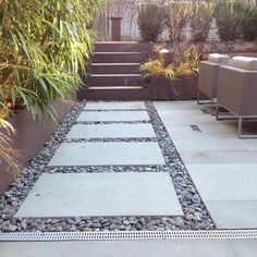 Modern Walkway: Concrete Pads & Large Pebbles