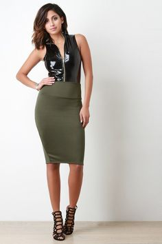 @modaonpoint This pencil skirt features a high waisted design, stretchy sculpture fit, knee length hem, and a vent slit at back. Accessory sold separately. Made in U.S.A. 92% Polyester, 8% Spandex.