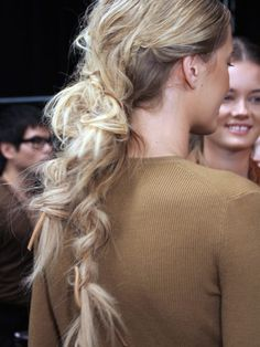 Michael Kors-Thanks to the loose, messy, leather-accented braids, the models' hair took on the safari vibe