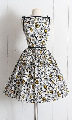 ➳ Vintage 1950s Dress  Darling vintage dress by Lanz Originals. Heavy cotton with whimsical paisley print, black pique trim and ribbon shoulders, full skirt, acetate lining with built-in crinoline, button back closure. Adorable!!  Excellent condition - no flaws. Fits like Medium.