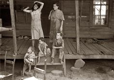 """Summer 1936. Children of sharecropper Frank Tengle at their Hale County, Alabama, cabin. 35mm nitrate negative by Walker Evans. According to James Agee, Evans allowed the mothers to clean up their children, if they desired, before he photographed them. Candid shots were not to be achieved at the cost of shaming the families beyond the shame they already felt. The Tengle family, along with their neighbors were the subject of the book """"Let Us Now Praise Famous Men"""" by James Agee and Walker Eva..."""