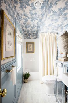 A lovely blue and white bathroom full of character and detail. Love the wallpapered ceiling and high gloss painted walls. Design by Shaun Smith Home - wallpaper - Raphael by Sandberg