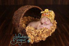 Dark Yellow Pom Pom Blanket Newborn Photography Prop 'Golden' Mustard Brown PomPoms. $65.00, via Etsy.