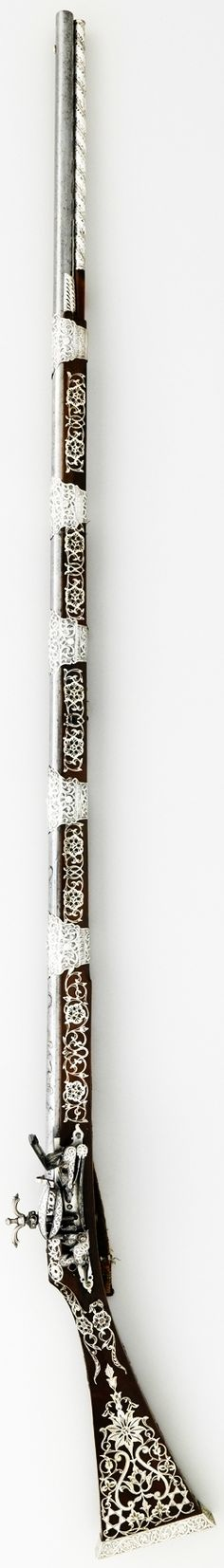 North African (probably Algeria) miquelet gun, dated 1224 (A.D. 1809) belonging to Ali Pasha, steel, wood, silver, textile, L. 67 in. (170.2 cm), Met Museum.