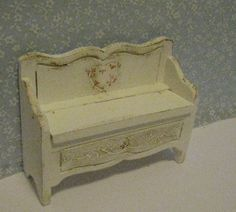 Very small childs bench, shabby chic with hand painted roses dollhouse miniature, twelfth scale. $10.00, via Etsy.