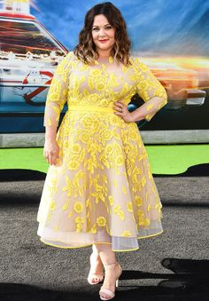 Melissa McCarthy in a yellow floral tulle tea-length dress
