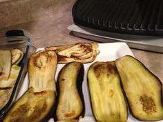 Slice Eggplant of an inch Spray EVOO on a baking pan and bake eggplant on both sides until it browns Eggplant Rolls, Baked Eggplant, 1 Egg, Stick Of Butter, Baking Pans, Spinach, Stuffed Mushrooms, Vegetables, Food