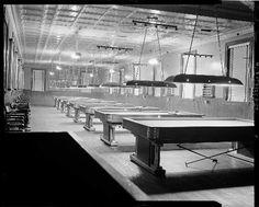 The back poolroom section of Woogie Harris's Barbershop