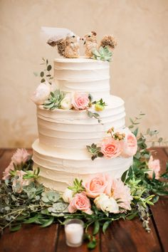 Three tier squirrel topped wedding cake that just makes you want to smile: http://www.stylemepretty.com/missouri-weddings/new-melle-missouri/2017/01/03/a-classic-vineyard-wedding-fireworks-fur-baby-included/ Photography: Erin Stubblefield - http://www.erinstubblefieldweddings.com/