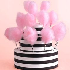 Cotton candy stand.  Black and white stripes.