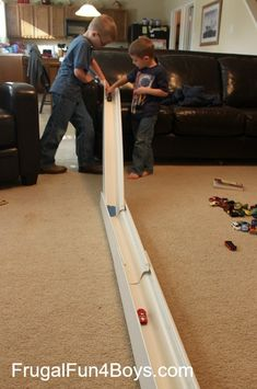 Hot Wheels Car Races with Rain Gutter Track  http://frugalfun4boys.com/2013/11/11/hot-wheels-races-with-rain-gutter-ramps/