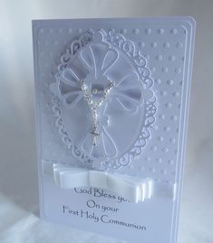 White Luxury First Holy Communion Card Made from a bright white card designed with an embossed background with an ornate cross on a raised lace effect topper completed with a small white/silver faux pearl rosary finished with a lovely pleated . First Communion Cards, Première Communion, First Holy Communion, Confirmation Cards, Baptism Cards, Handmade Christening Cards, Christian Cards, Communion Invitations, Sympathy Cards