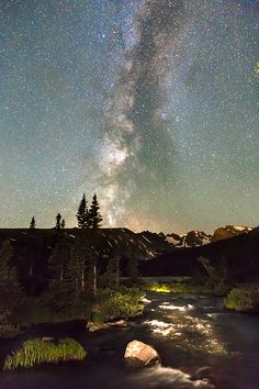 Rocky Mountain Night - Scenic astrophotography image, late night or early morning with a starry sky view of the Milky Way towering above Longs Lake, creek and the #Colorado Rocky Mountains Indian Peaks. #nature #insognaGallery #art #wallart #Artprints #homedecor #gifts