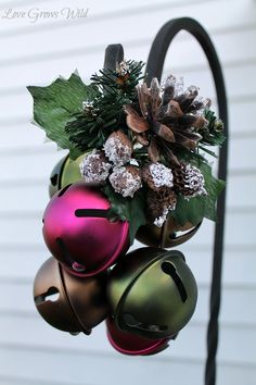 A Southern Christmas/karen cox.Jingle Bells hung on a Garden Hook by Love Grows Wild - A great way to use garden hooks after your hanging flower baskets are done! Christmas Porch, Christmas Bells, Simple Christmas, Winter Christmas, All Things Christmas, Christmas Holidays, Christmas Wreaths, Christmas Ornaments, Apartment Christmas