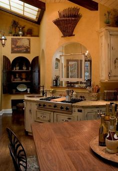 Oh, I love the rustic look...looks so homey and inviting, makes me want to bake bread! i like the unusual shape of the kitchen!