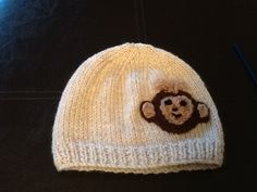 Baby hat with monkey motif