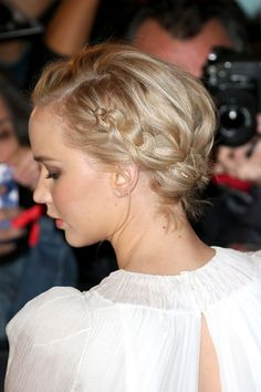 For the Paris premiere of The Hunger Games: Mockingjay Part 2, Jennifer Lawrence chose a pretty plaited up-do woven with a jewelled chain.
