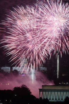 Fireworks light the sky over the U.S. Capitol, left, the Washington Monument and the Lincoln Memorial during Fourth of July celebrations, Thursday, July 4, 2013