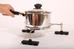Potsafe is the #1 child safety accessory for the kitchen. This innovative product fits over induction & glass electric stove tops, locking pots in position.  www.potsafe.com