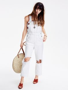madewell overalls worn with the straw circle bag + crisscross sandals. call 866-544-1937 or email shopfirst@madewell.com to pre-order.