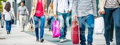 Group Of People On Sidewalk With Shopping Bags royalty-free stock photo