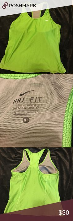 Nike dri fit work out tank with bra inside Nike dri fit extra large work out tank with bra inside. Clean smoke free home please make a a reasonable offer. Nike Tops Tank Tops