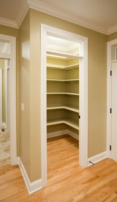Kitchen panty that uses all wood shelving and corner shelves in the design to maximize storage space.
