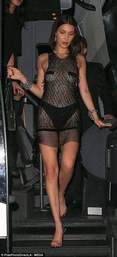 Turning heads: Bella Hadid, 20, let loose for the Met Gala afterparty at New York's 1OAK as she slipped into a sheer slip dress that flaunted her phenomenal figure