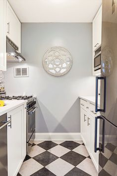 Treanna's galley kitchen gets a boost of storage and style—including four pull-out custom racks—in this Upper East Side renovation. 60s Kitchen, Updated Kitchen, Kitchen Ideas, Cabinet Toe Kick, Tiles Direct, Grey Palette, Galley Kitchens, Mosaic Backsplash, Hidden Storage