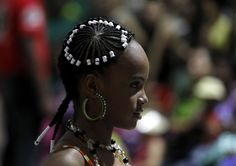 A woman presents an African-Colombian hairstyle during the Afro-hairstyles X Competition in Cali