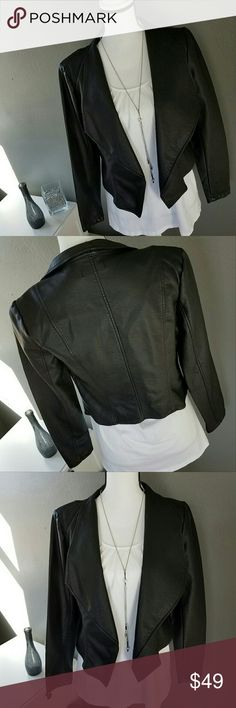 Black Vegan Leather Drape Front Crop Jacket *NWT, Never Worn* Black vegan leather crop jacket features drape front collar, and cropped cut. Fully lined. This jacket is a must have for every closet and will incorporate well into your casual, work, and evening attire.  Approx. measurements 23.5 inches length in front (to bottom of drape), 17 inch length in back, 17 inch bust, 23.5 inch sleeve. 100% Polyester. Machine washable. Accessories Not Included. Offers and bundles warmly welcomed…