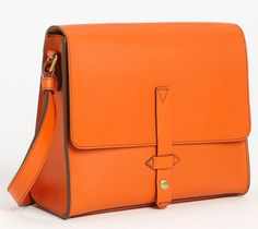 With the amazing orange color and the simple, workmanlike construction, the IIIBeCa by Joy Gryson Duane Crossbody has a bit of an Hermes-esque aesthetic to it, but without the Hermes price tag.
