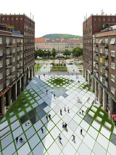 location: Madách square / Budapest The Madách square is situated in the center of Budapest, and now used as a parking area. Our proposal was designed for a student competition. Our goal was to create a multipurpose square, that fits in the existing environment. For that reason we wanted mostly a covered place. On the other hand, creating more greenery in the downtown is also necessary. We combined this two needs and introduced a new pavement.