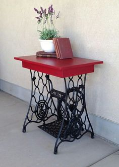 So cute. Table made from old sewing machine base. I've been wanting to do this for a long time.
