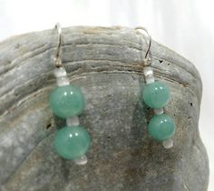 Green beaded drop earrings on handmade sterling silver earring