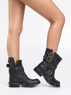 - These gorgeous leather booties are distressed, tough, oiled and aged to perfection - Hand-distressed with vintage premium leather allow for a rugged look - Fashioned with belts and wrap-around buckl